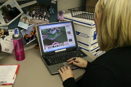 Jessica Walton tends to her Farmville farm on Facebook during down time.