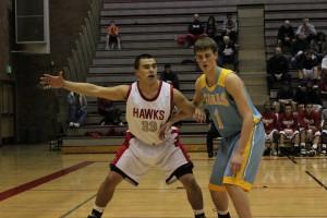 Senior forward Mitch Haldane posts up an Everett player in the Terraceum.