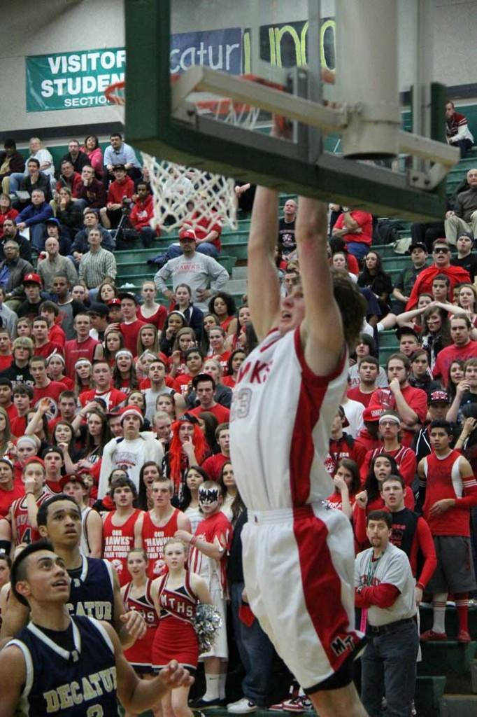 Ryan Shannon dunks as the Rowdy Rooters and Gators look on in the third quarter of Friday's game.