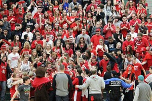 The Rowdy Rooters begin to celebrate following the Hawks' victory over Decatur.