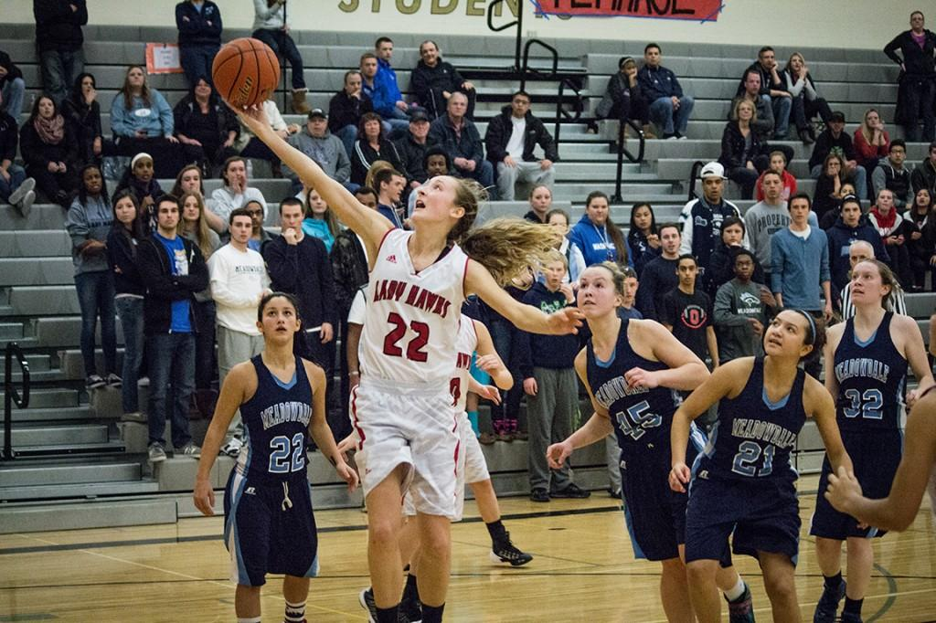 Junior forward Samantha Romanowski drives to the hoop in the 4th quarter of the Hawks victory over Meadowdale.