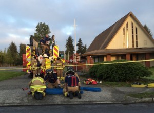 Firefighters finish packing their gear following a devastating fire at Mt. Zion Lutheran Church early this  morning just north of Mountlake Terrace High School on 44th Ave. W. One firefighter was slightly injured in the blaze.