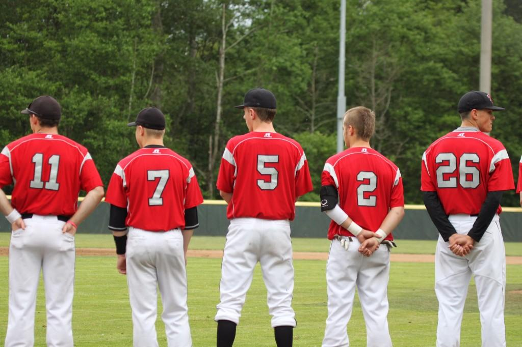 The Hawks line up prior to the start of the game.