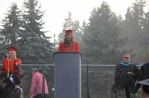 Monika Young delivers her speech in the downpour.