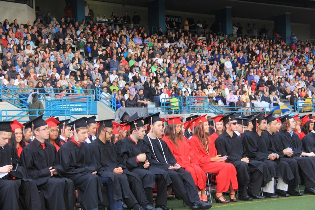 Graduates sit waiting for the commencement to begin.
