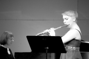 Lucy Schermer (right) performs a piece at her senior flute recital on May 9 at the MTHS Theater, accompanied by pianist Kristine Anderson (left).