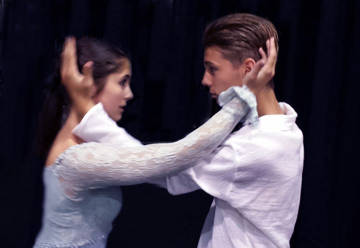 Senior+Emily+Davidson%2C+playing+the+role+of+Juliet+and+sophomore+Everett+Amundson%2C+playing+Romeo%2C+embrace+during+rehearsal+for+the+upcoming+production.+