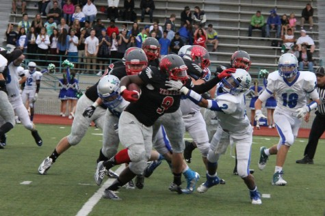 Senior fullback Malcom Johnson stiff arms a Shorewood player.