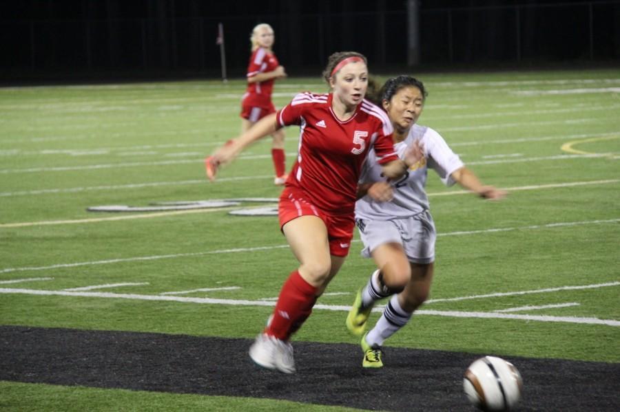 Senior+midfielder+Allison+Lorraine+battles+a+Royal+player+for+the+ball.