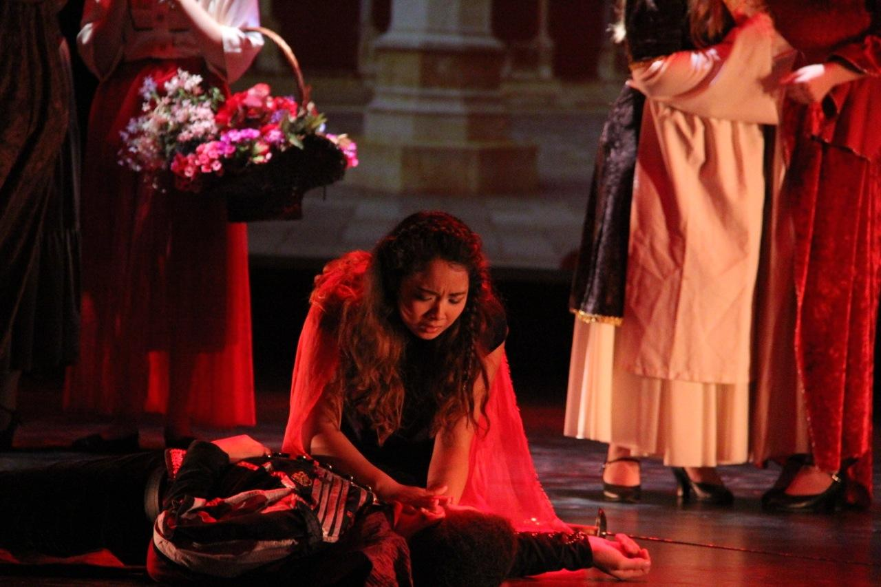 Lady Capulet played by Hirano weeps over the body of Tybalt, played by Damon Dahl.