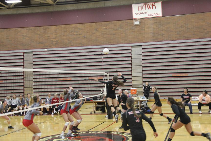 Senior Emily Eich goes up for a hard return during Wednesday's game.