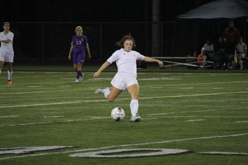 Senior+midfielder+Allison+Lorraine+kicks+the+ball.