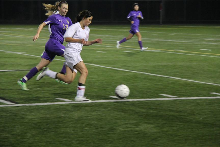 Freshman forward Isabel Kembel dribbles the ball down the line.