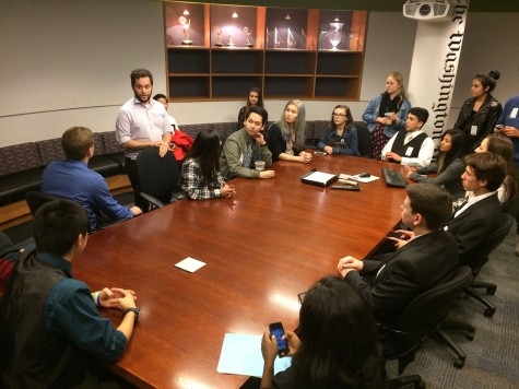 Hawkeye staff members meet with the Washington Post's Timothy Smith in the A1 Decision Room in the Post's headquarters in Washington D.C. on Nov. 6, 2014.