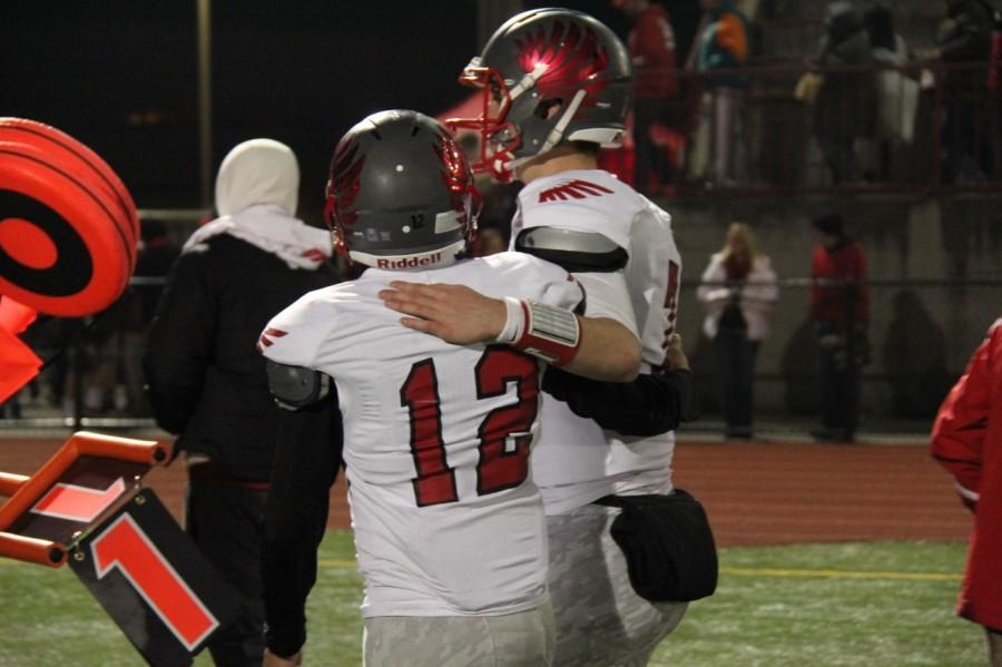 Bravo puts his arm around Justin Hopkins.