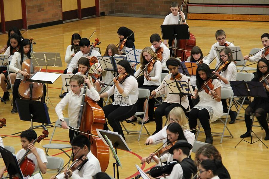 Seventh and eighth grade orchestra students play during the combined piece, William  Tell Overture.