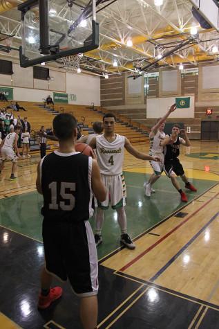 Junior Joey Gardner passes the ball into play.