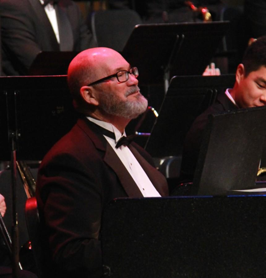 Scott+Barnes%2C+Edmonds+School+District+music+director%2C+as+french+horn+stand-in+at+the+bands+nutcracker+concert.