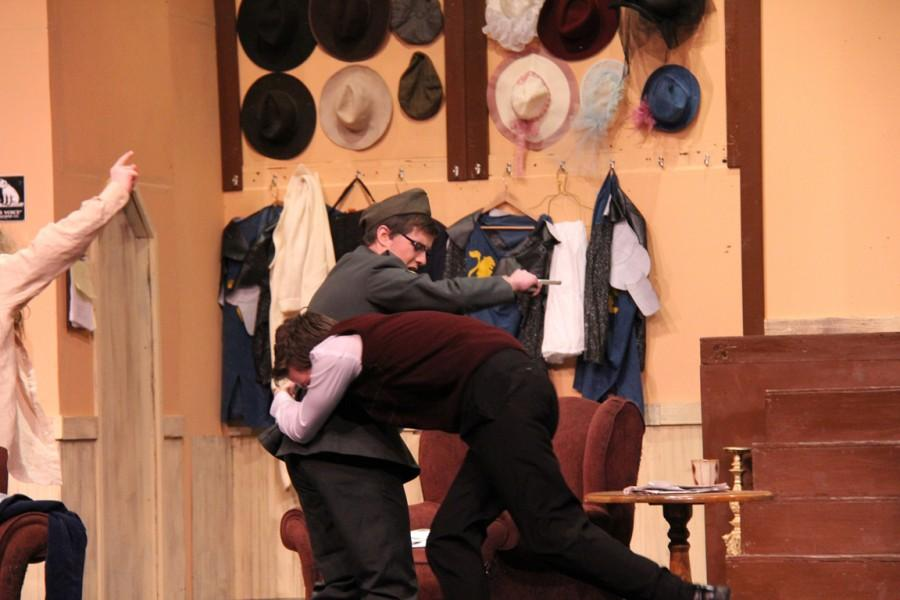 Freshman Sam Schippers as Paul, tackles sophomore Paul Pratt who was portraying Howard.