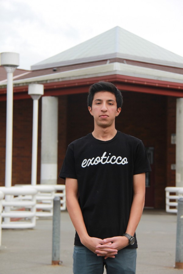 Shakil poses in his own Exoticco shirt outside MTHS front door.