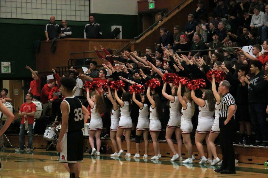 The Mountlake Terrace cheer team and the pep band raises their spirit fingers in anticipation of a free throw.