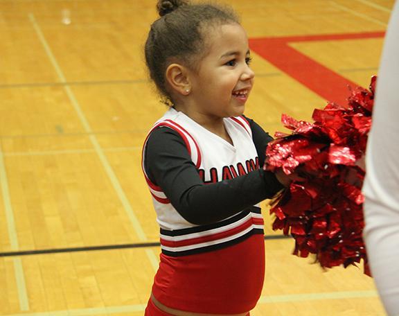 A little Hawk fan cheers on the women's basketball team