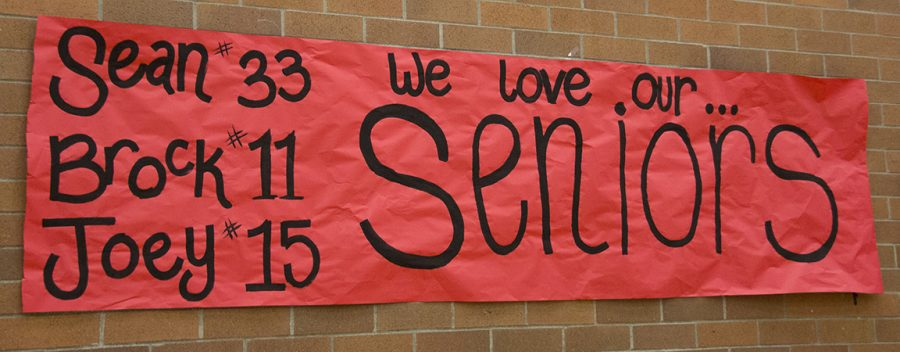 A+poster+made+by+the+MTHS+cheer+team+to+honor+the+seniors+on+the+basketball+team