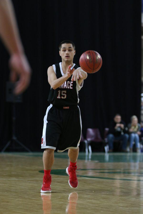 Senior Joey Gardner passes the basketball.