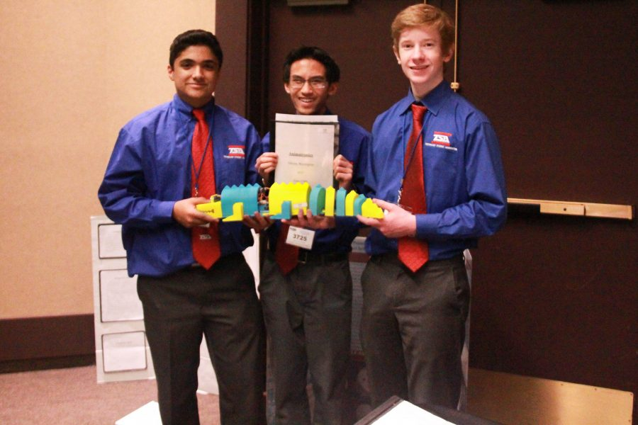 Sophomores Matthew Khajehpour, Reiden Chea and Reece Newhouse holds their 2nd place Animatronics entry.