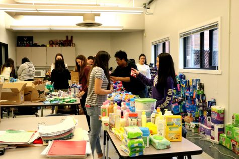 Key Club moves their collected items into separate categories that will later be divided into bags for homeless shelters.