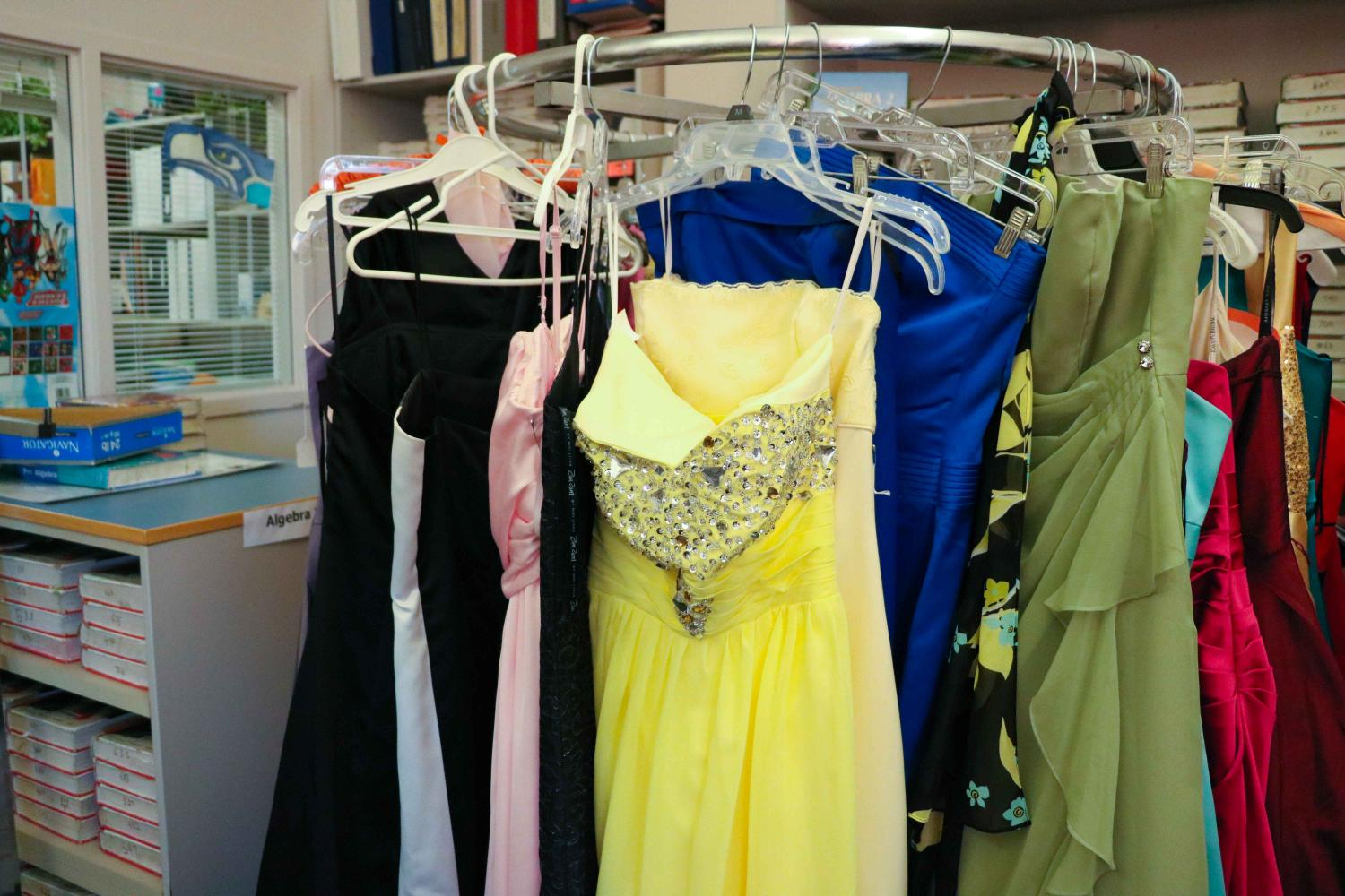 A rack of the free prom dresses available for students in the Fines Office, which were donated by families during Glamour Day.