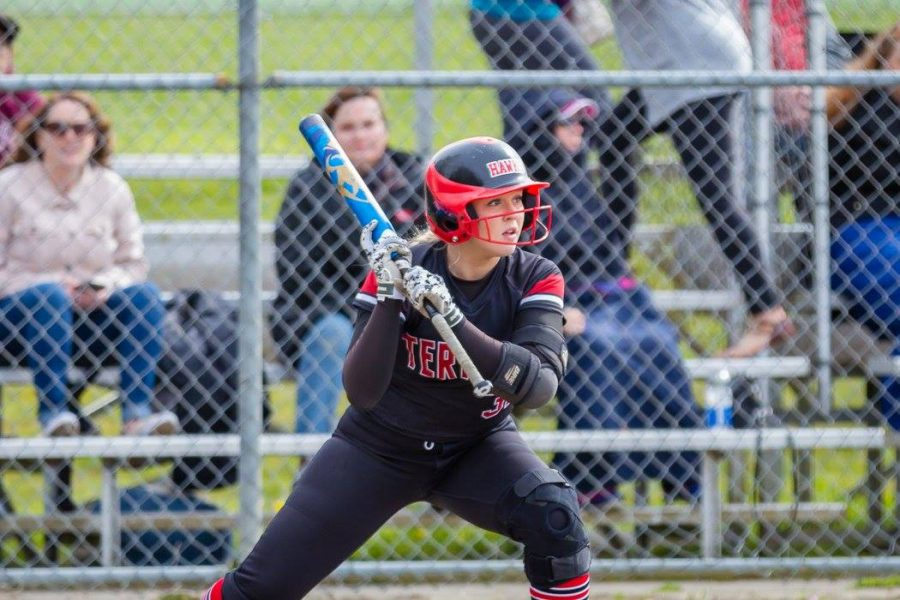 Junior third base and catcher Jasmine Zenk gets in position for an incoming pitch. Zenk is positive of the team qualifying for state competition later this season.