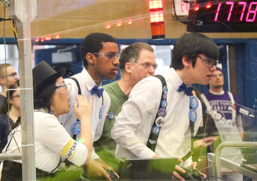 Chill Out members look at the field in anticipation as they compete in the PNW District Competition. The team will advance this year to the national competition in Houston as one of only 39 teams from the northwest region.