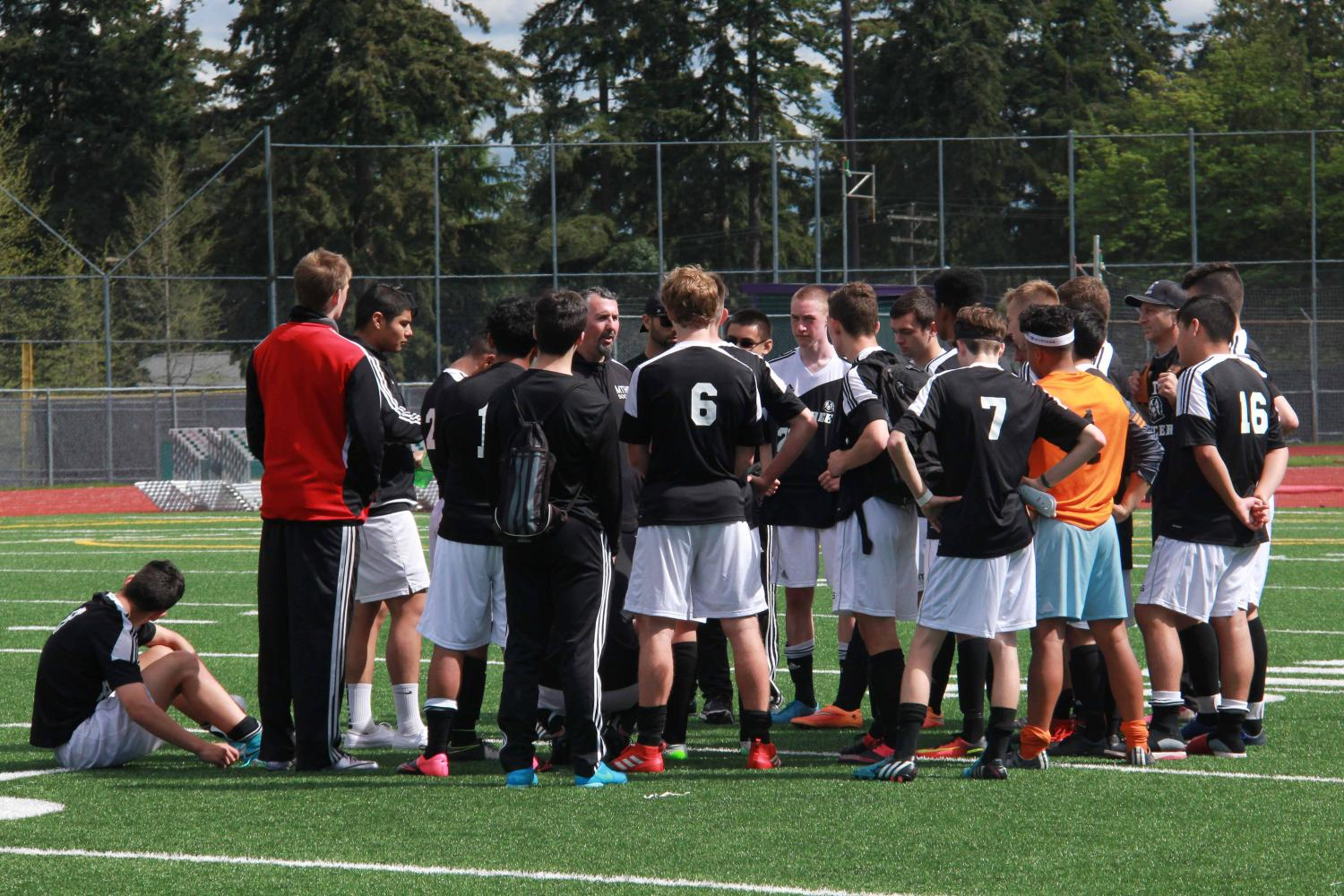 The Hawks gather for a group huddle at the end of the game after suffering a loss in a 2A District match.