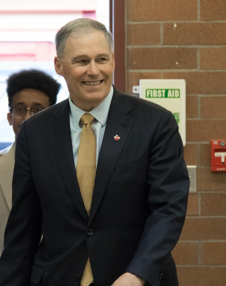 Governor Inslee enters the school through the shop in the STEM wing.