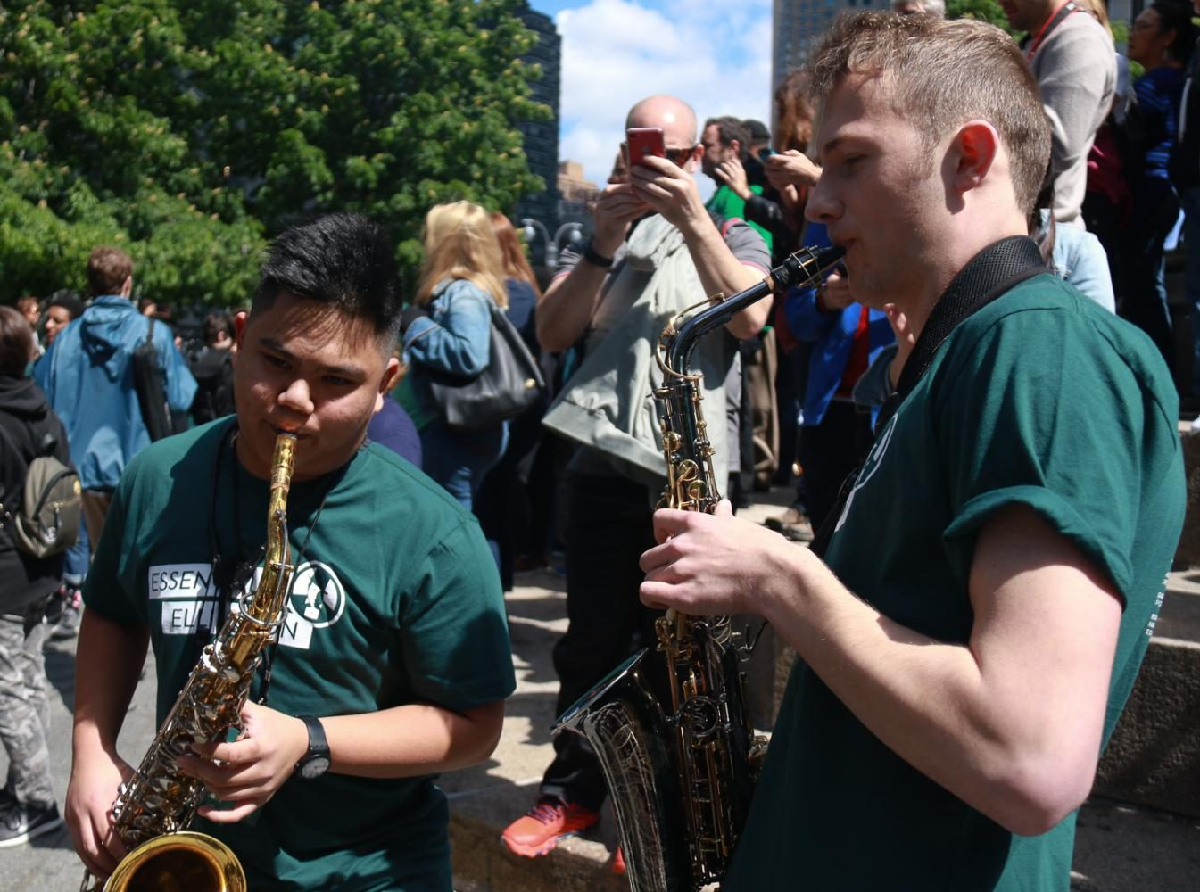 MTHS senior Andrew Sumabat improvises with EWHS senior Brandt Fischer while waiting for the parade to begin.
