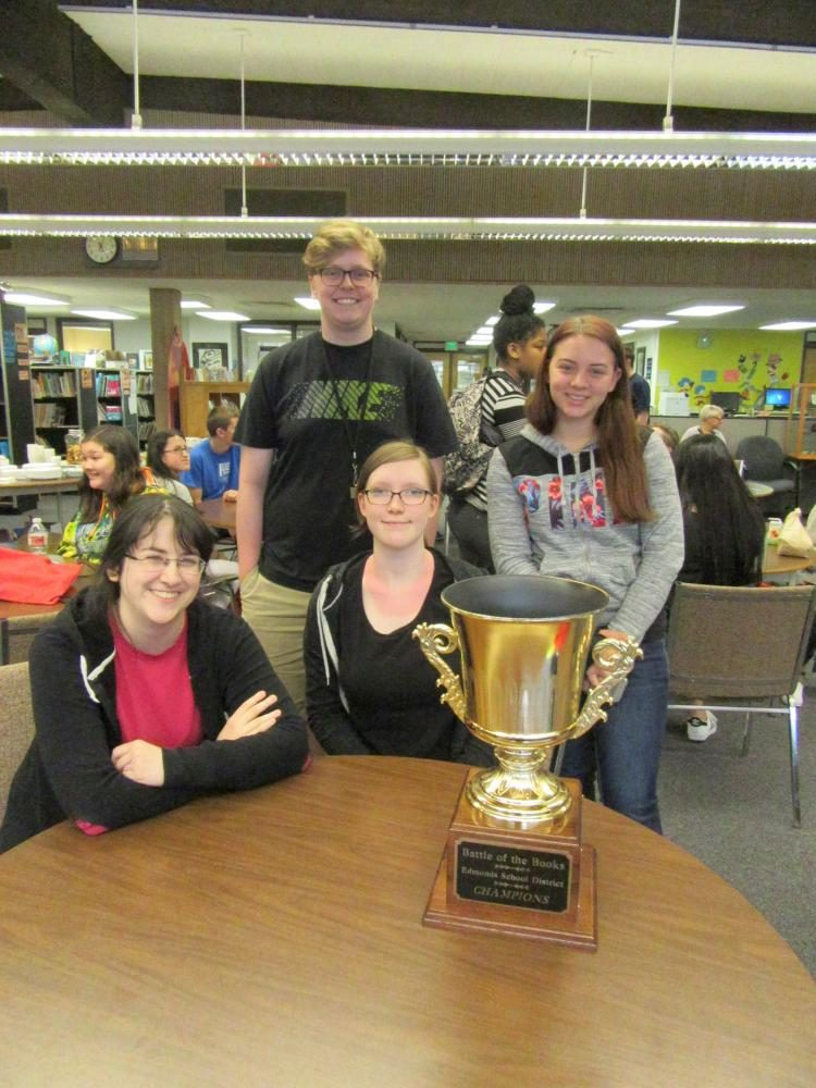 The winning team poses with their first place Battle of the Books 2017 trophy. Three of the members are returning competitors while this was the first competition for another member. Photo courtesy of Kasey Meier.
