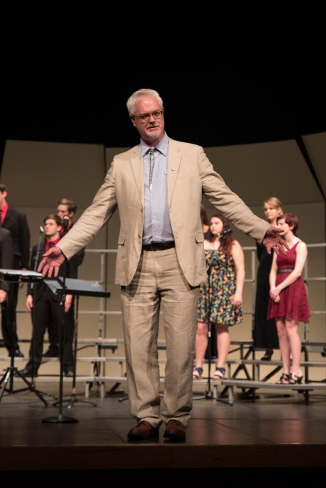 Choir director T.J. Sullivan begins the show with an inspiring speech.