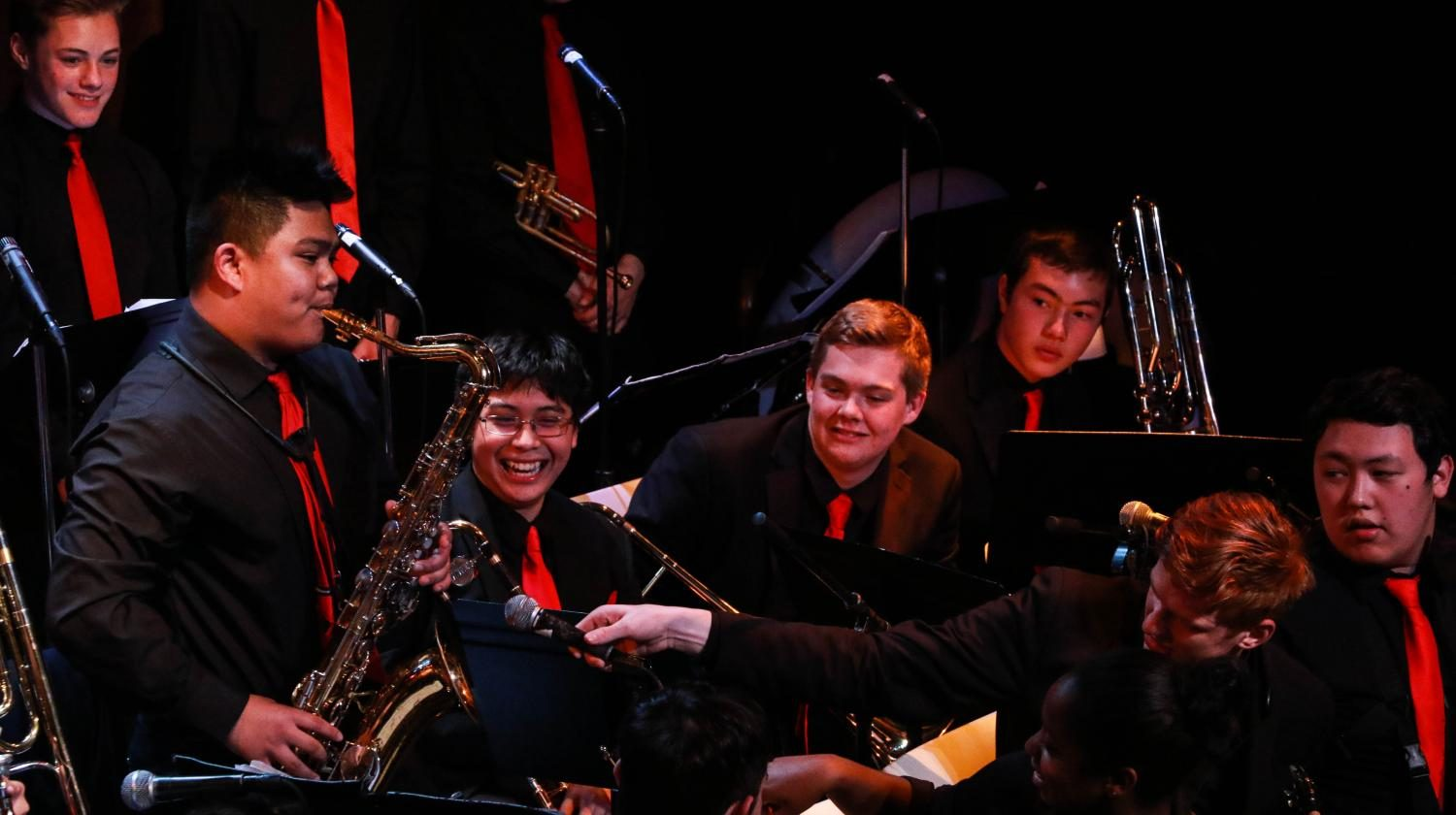 Senior Andrew Sumabat picks up his third instrument of the night to wow the crowd with another energetic solo with the help of mic-holder Max Knibbe.