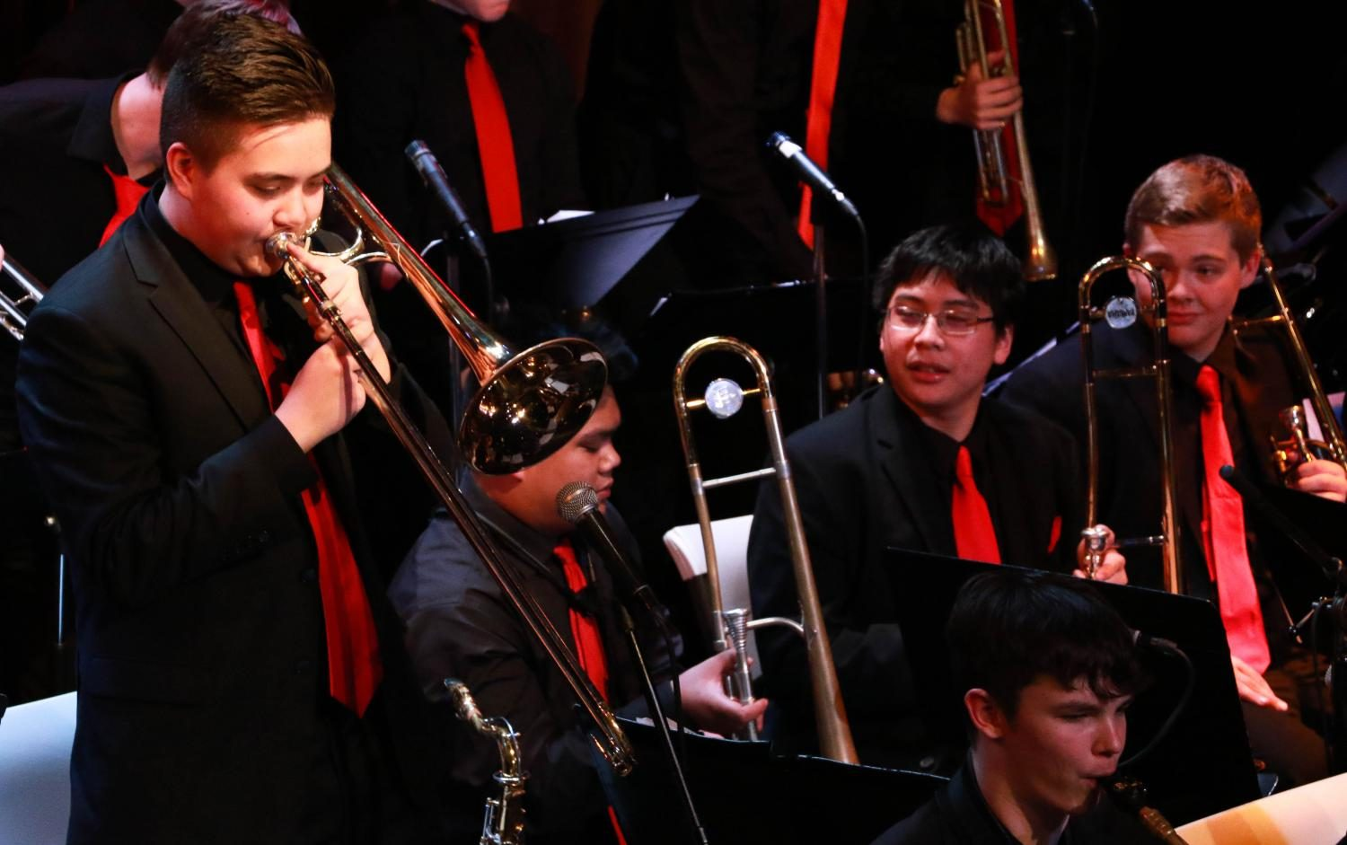 Ethan Pyke solos as his fellow trombone players watch and listen.