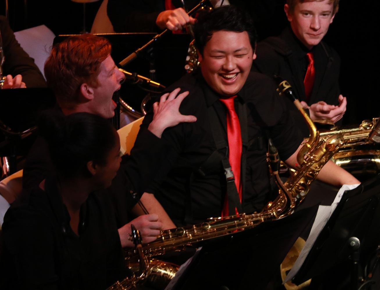 Max Knibbe cheers as Simon Zombors name is called by director Darin Faul. Each member of the band, especially the seniors, were celebrated at Jazz Alley.