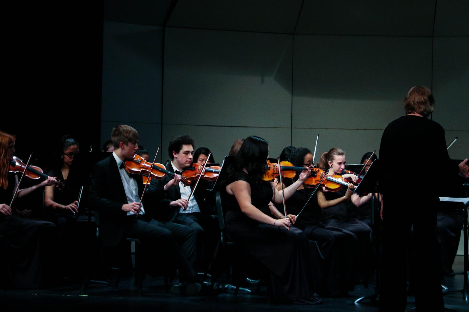 Concert Orchestra concentrates on their performance.