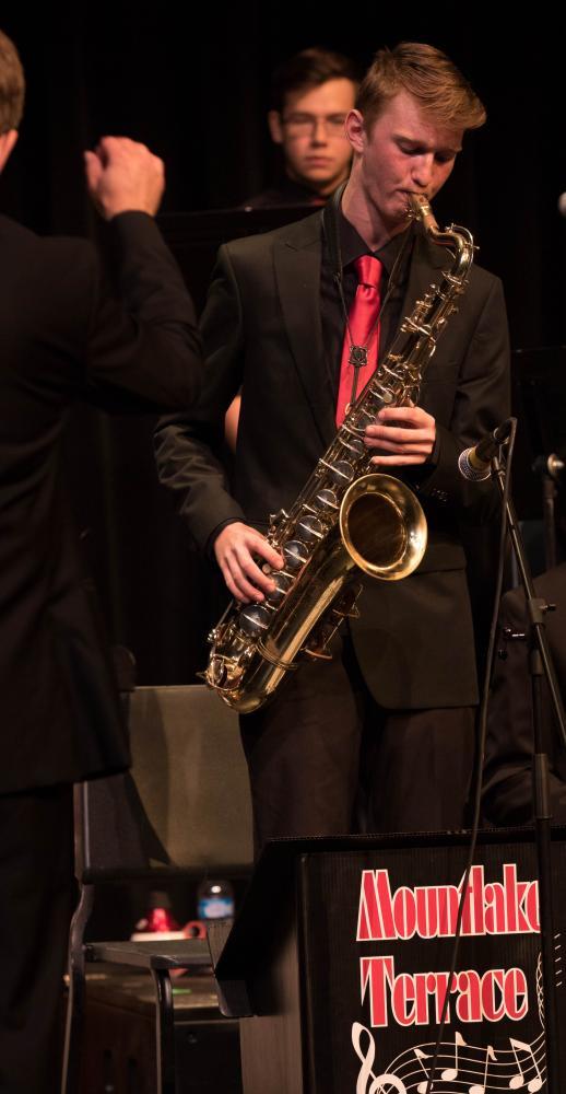 Junior Ben Leonard solos in his first jazz concert as a Hawk.