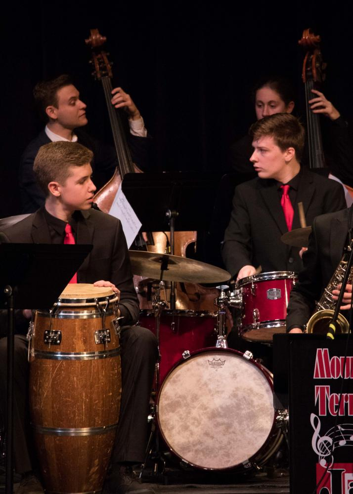 Percussionists Josh Setala and Kieran Faris keep ears and eyes open towards bass players Alex Frank and freshman Andrew Vinther.