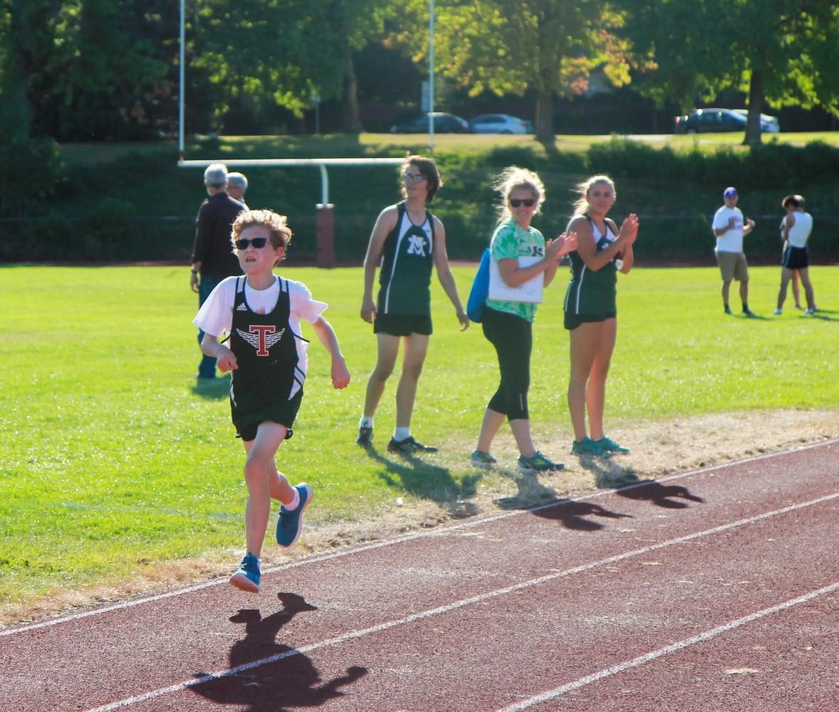 Benjamin Hawkins running to the finish line.