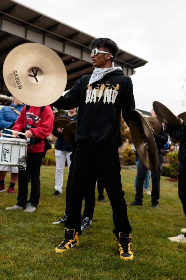 A cymbalist from Lynnwood High School gives an animated performance with the rest of the Edmonds School District drumlines.
