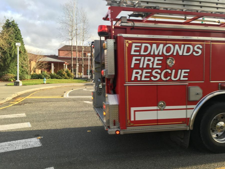 The+Edmonds+Fire+Rescue+truck+drives+past+the+front+of+MTHS.