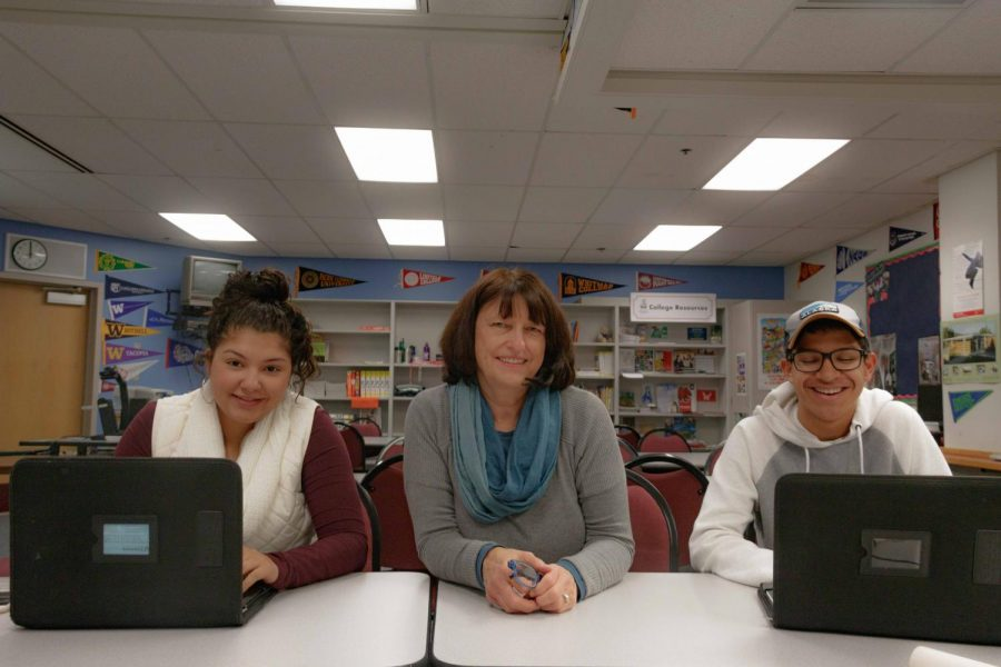 As seniors Jazmyn Burn-Seipp and Kenneth Morris-Fagan continue their last year of high school, Barb Brister enthusiastically works with them to plan their future beyond high school.