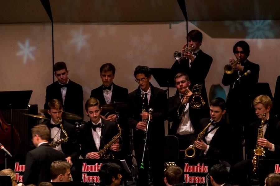 Junior Reiden Chea plays his clarinet.