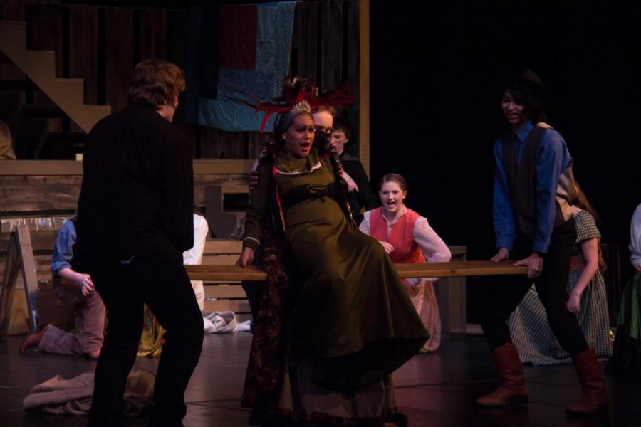 Bidding a final farewell, the ensemble eagerly watches the evil Salome go to her doom.